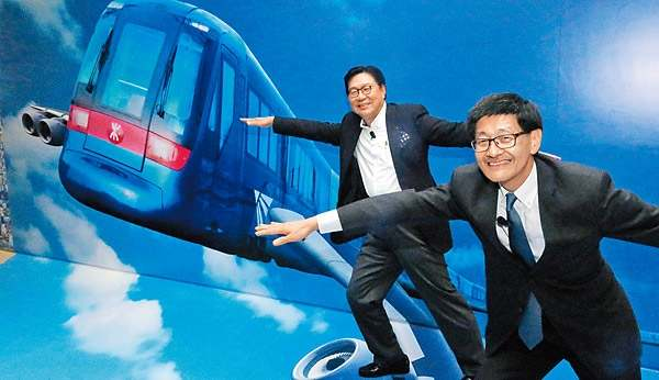 Frederick Ma, new chairman of MTR Corporation(left), and Lincoln Leong, CEO of MTR MTR Corporation, have called on lawmakers to approve additional budget to help complete a cross-border rail project.