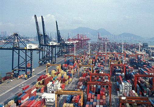 Shipping containers and cranes stand at the Kwai Tsing Container Terminals in Hong Kong.